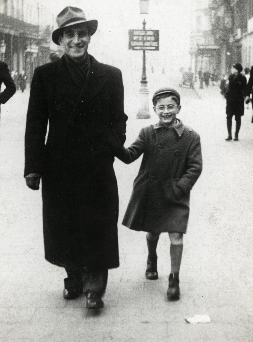 Michel Werber walks down the street holding hands with his father Abusz.