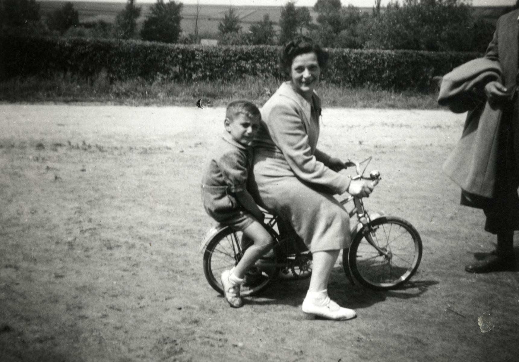 Michel rides on a bicycle behind his aunt, Paulina Trocki when she came to visit him in hiding.
