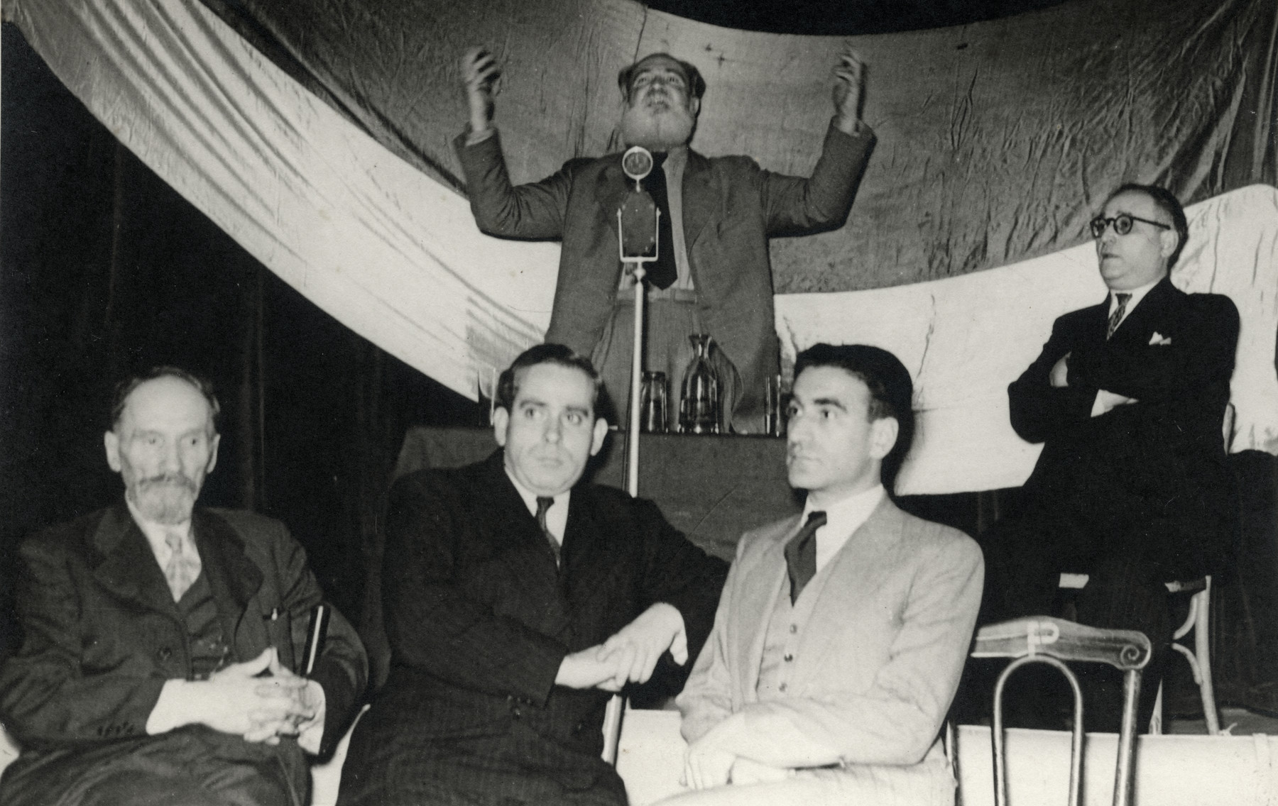 Jacob Zerubavel addresses a meeting of Poalei Zion in Belgium after the war.  Abush Werber is seated on the right.
