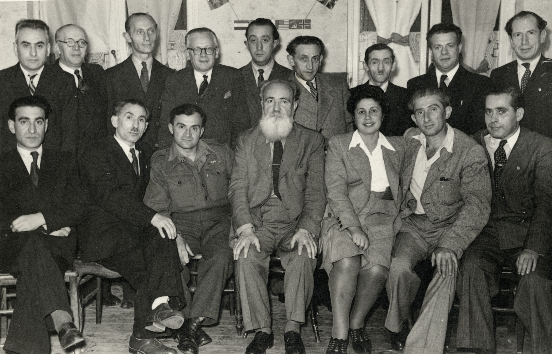 Members of Poalei Zion in Belgium.  Jacob Zerubavel is seated in the center.  Abush Werber is seated on the far left.  Joseph Epstein is standing on the right and the Jewish Brigade soldier Baruch Lelonik is seated third from the left.