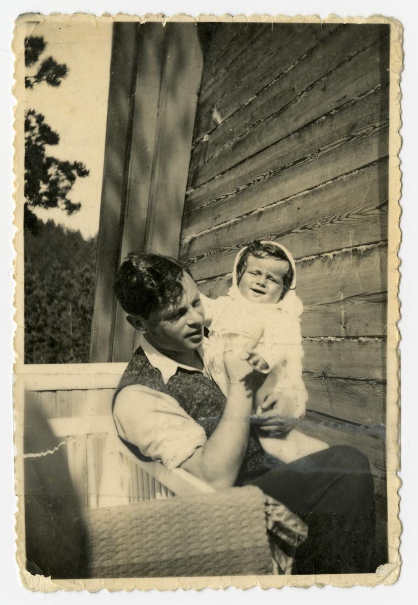 Paulius Bagriansky holds his baby daughter Rosian.