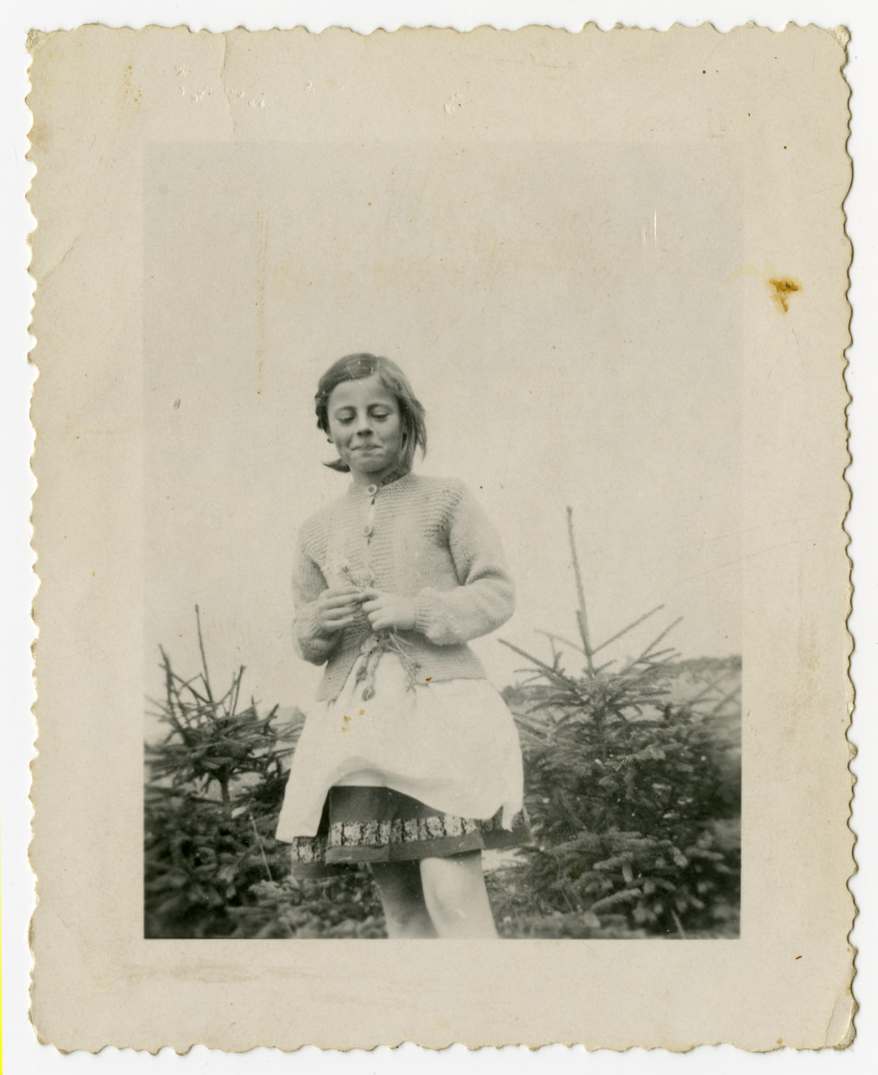 Rosian Bagriansky picks a flower outside on the farm of her rescuer Lidija Goluboviene.  In addition to Rosian, Lidija Goluboviene also hid two other Jews, Russians and a deaf mute.