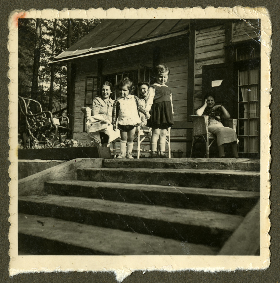 Members of the Bagriansky families relax outside a summer home in Kacerginai before the war.  Pictured are Rosian Bagriansky, her Aunt Lyda Bagriansky Geist and friends of the family. [Possibly Rosa Govshovitz and daughter.]