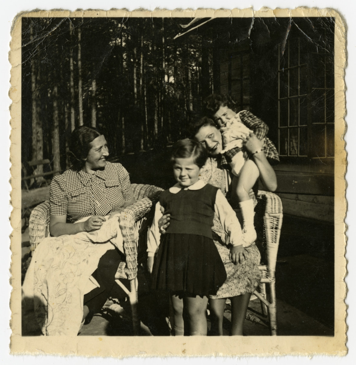 Rosian Bagriansky poses outside with her aunt Lyda Bagriansky Geist and family friends of the family [probably Rosa Govshovitz and her daughter] in either Kulautova or Kacergine Lithuania.
