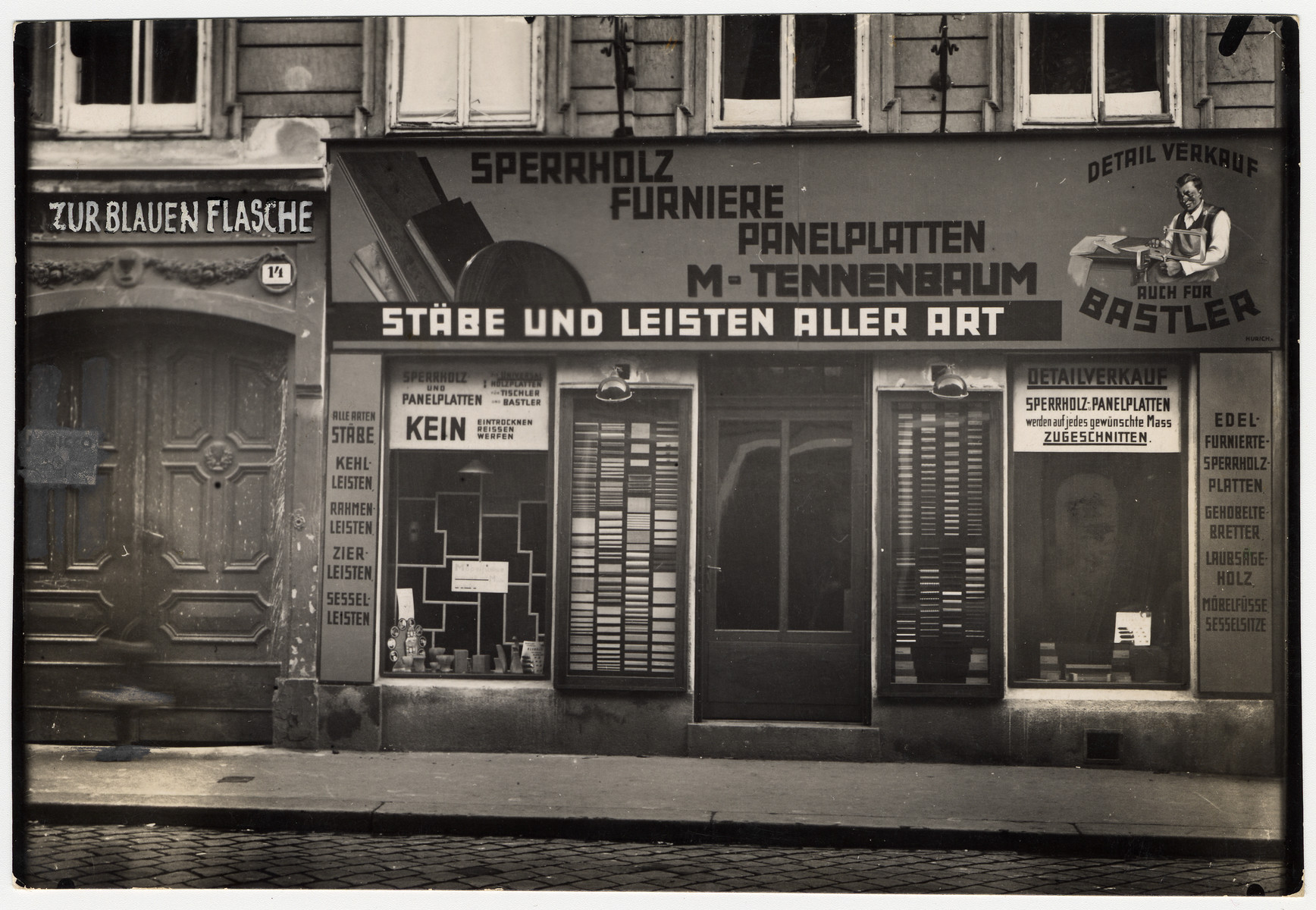 Mark and his family's retail store in Vienna XVI, Neulerchenfelder Strasse 14.  The storefront advertises such merchandise as plywood and veneer.
