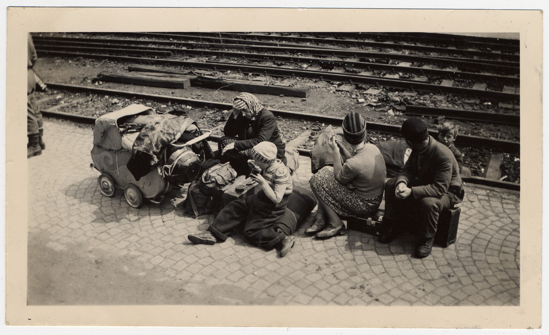 "German women wait for repatriation.  Original caption:  ""German refugees wait for transportation."""
