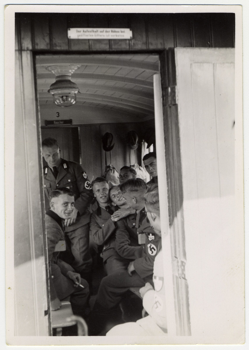 Members of the German army are pictured in a train car.