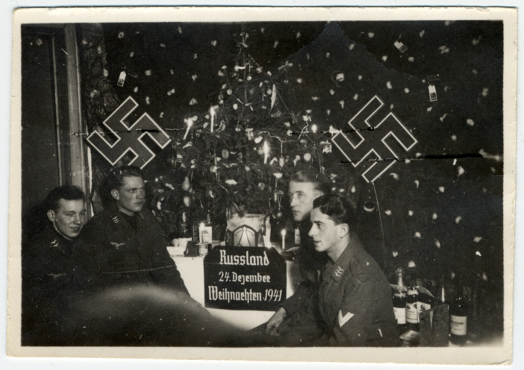 German soldiers on the eastern front relax at a Christmas celebration somewhere in the USSR.