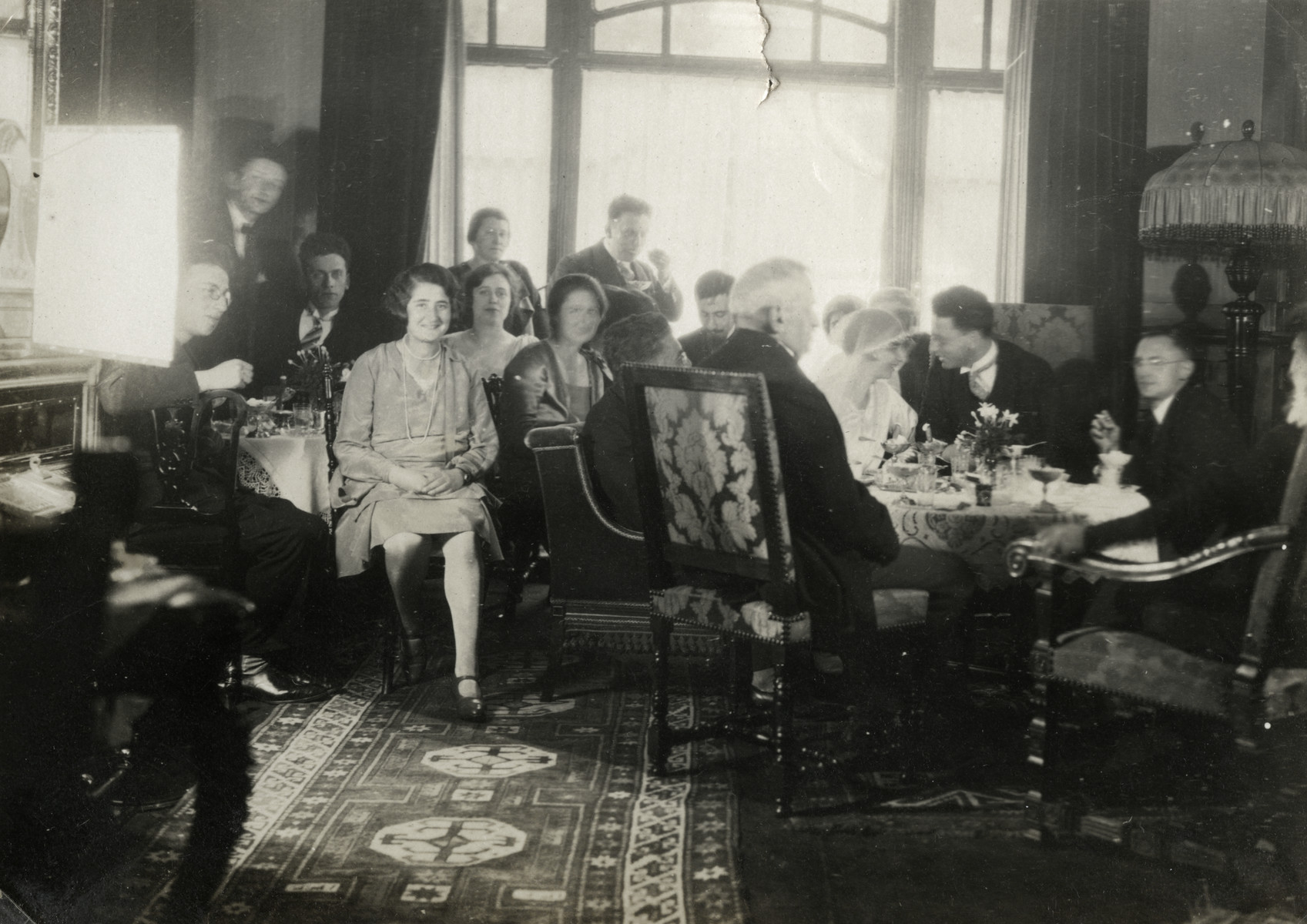 Wedding celebration of a Jewish couple in the Netherlands.  Pictured are the bride and groom, Else and Joseph Mossel; Joseph's brothers, Jacques and Aaron; Joseph's brother  and sister-in-law, Zadok and Annie Mossel;  and Else's father, Emanuelle Buchenbacher.  The celebration took place in the home of the donor's grandparents.