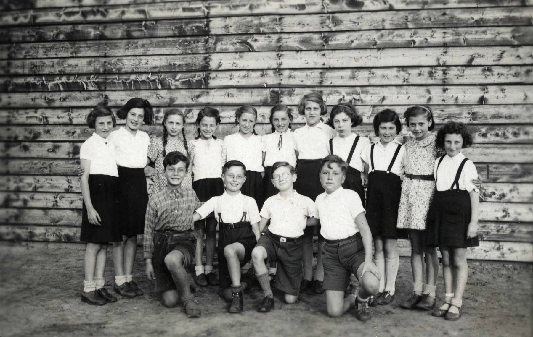Group portrait of school children in the Westerbork refugee camp.  Sonni Birnbaum is standing third from the left and her sister Regina is standing second from the right.