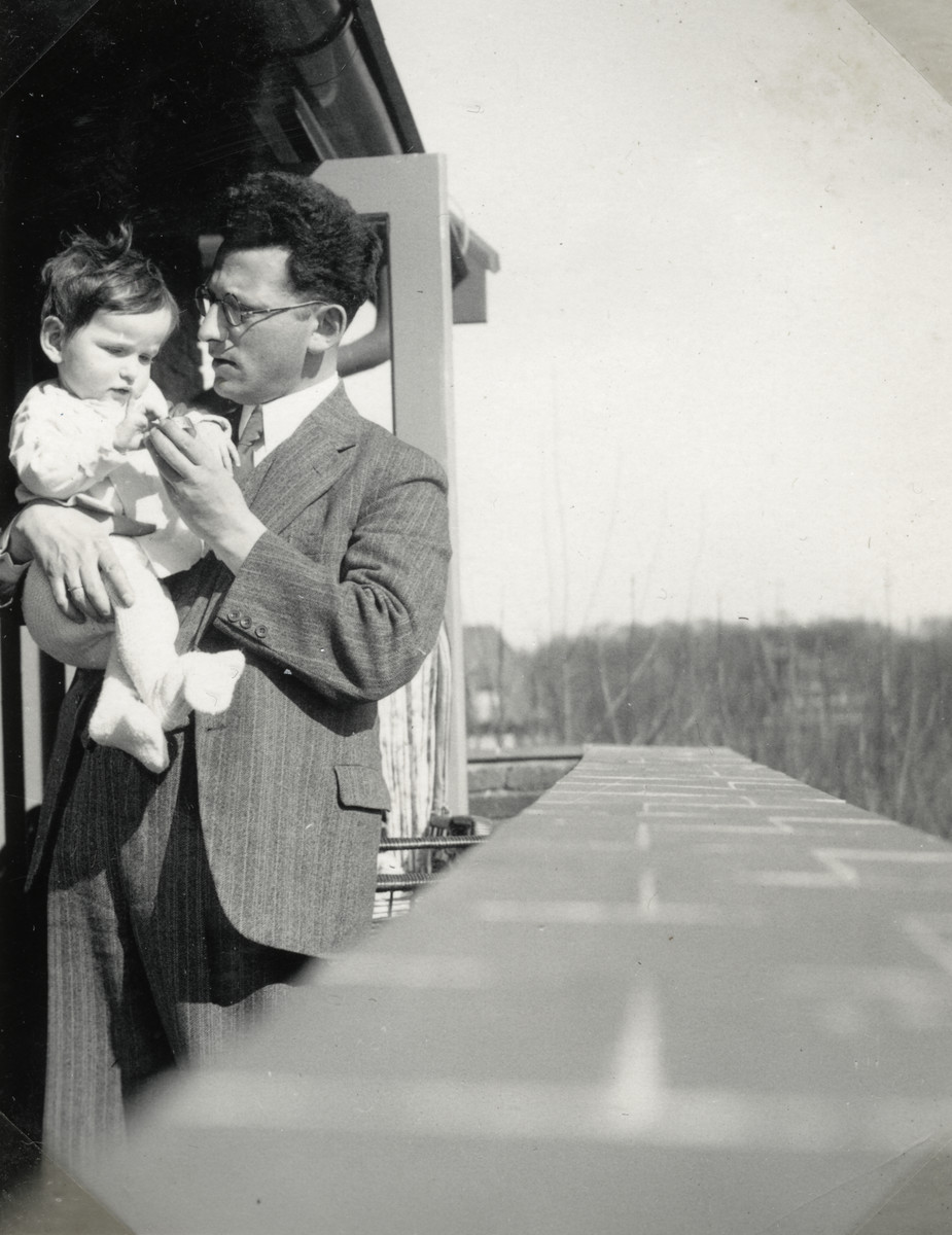 Joseph Mossel holds his year-and-a-half old daughter, Henriette.