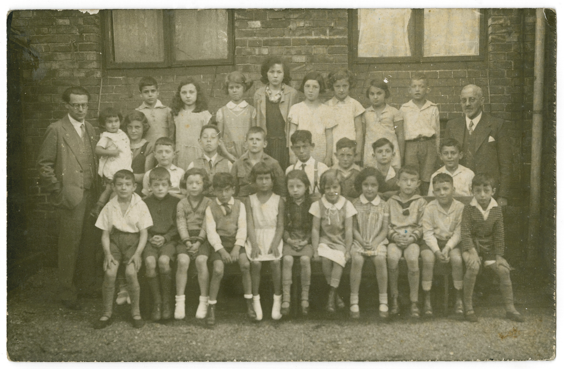Group portrait of a class in Hildeshein.  Doris Edelman (Nee Tager) is pictured third from the right in the top row.