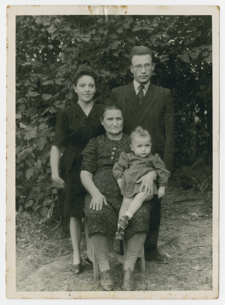 Portrait of the Dichter family in the Eschwege displaced persons camp.  Basia Dichter is holding her granddaughter Klara.  Standing are Pola and Izak.