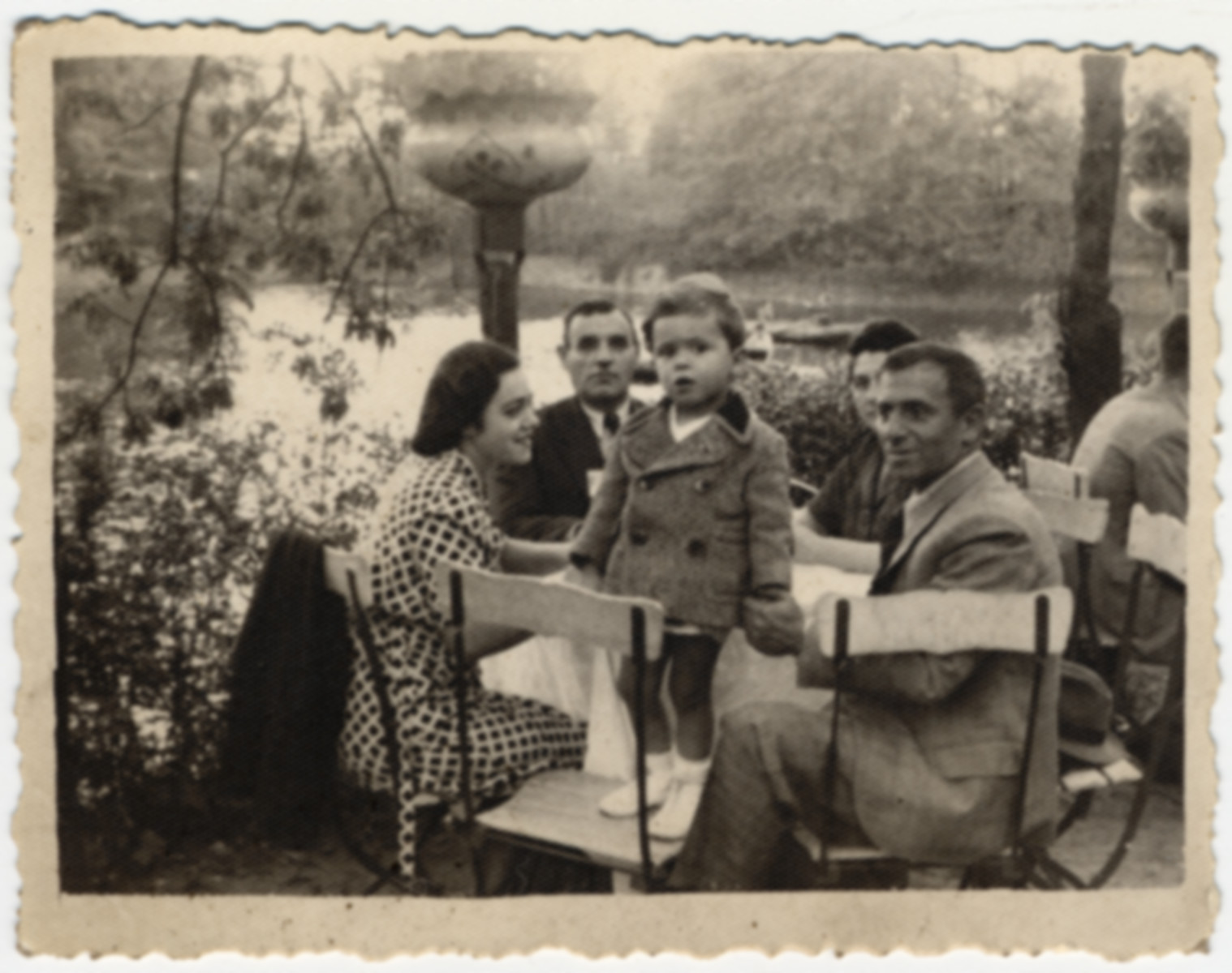 A Jewish family sits at an outdoor table near the Vitosha Mountains.  Pictured are Misha (front) with his parents, Gabriel and Victoria  Avramoff and their cousins (back).