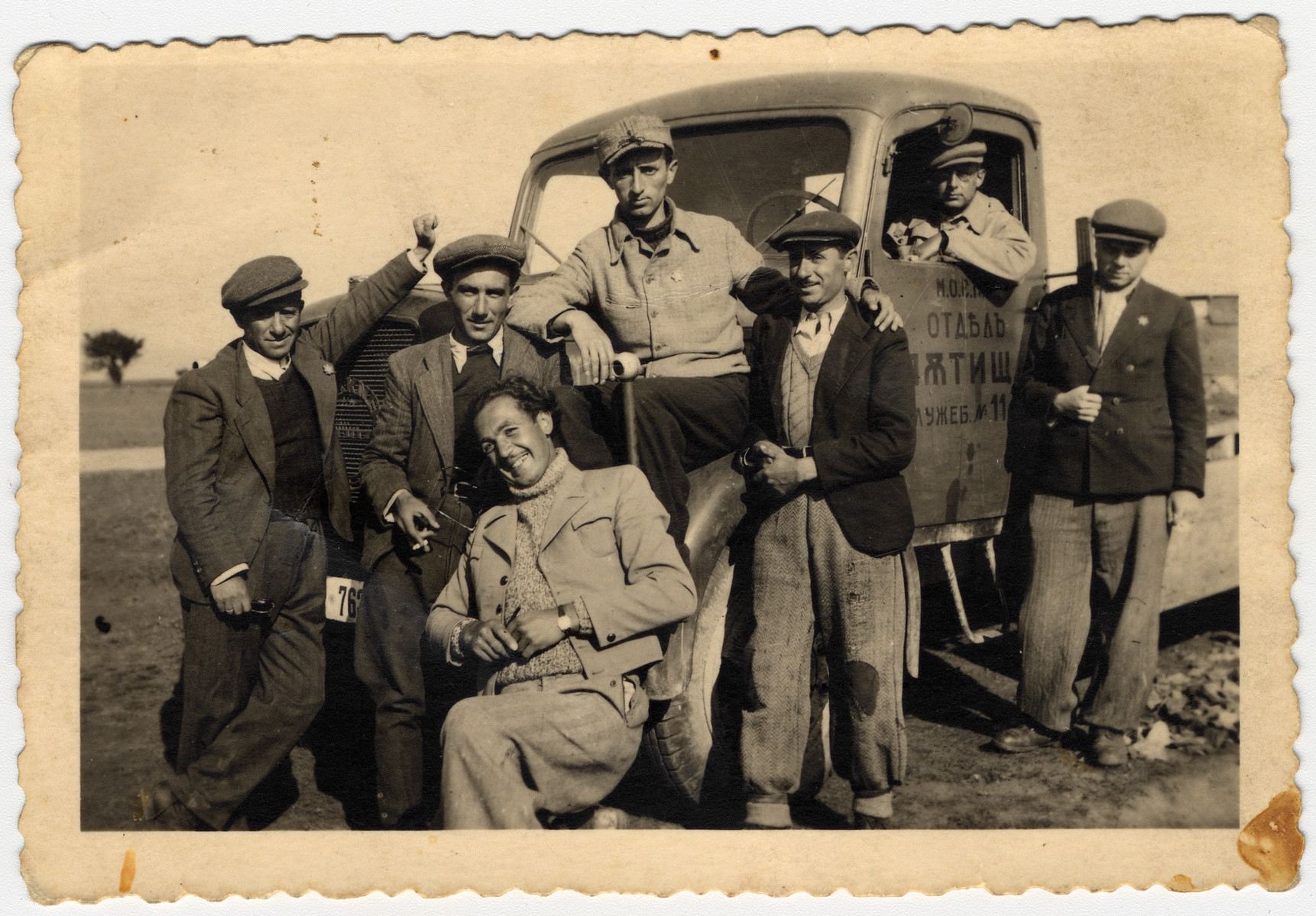 Jewish forced laborers pose next to a truck in Bulgaria.