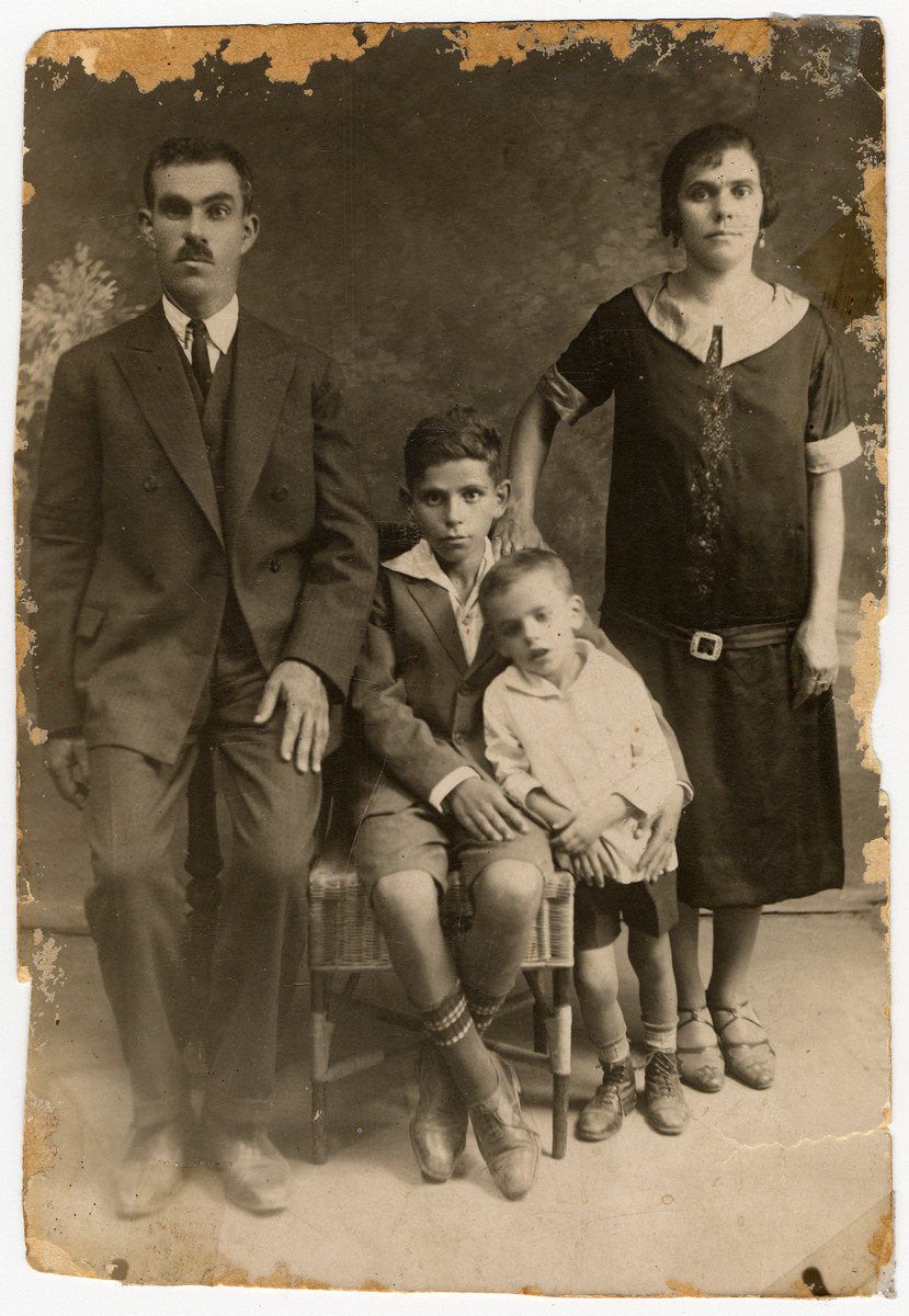 Prewar studio portrait of a Greek Jewish family.  Pictured are the Yaffes: Samuel, Joyia and their children, Mordo and Alberto.  Mordo died before the start of the war.