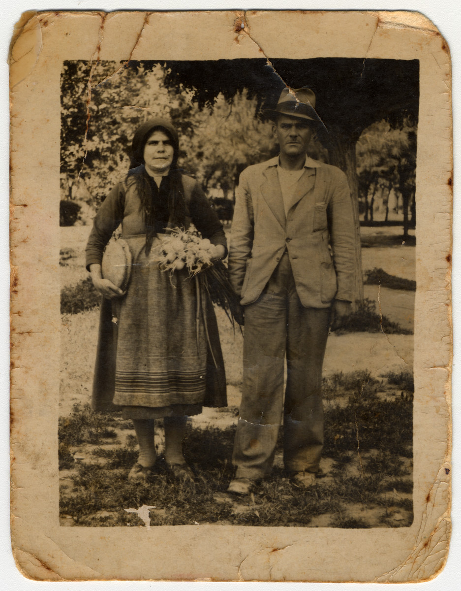 A Jewish woman, dressed in typical Greek costume, poses with her brother while hiding in the Greek countryside.  Pictured is Joyia Yaffe and her brother Haim Raffaes.  He was later captured and killed.