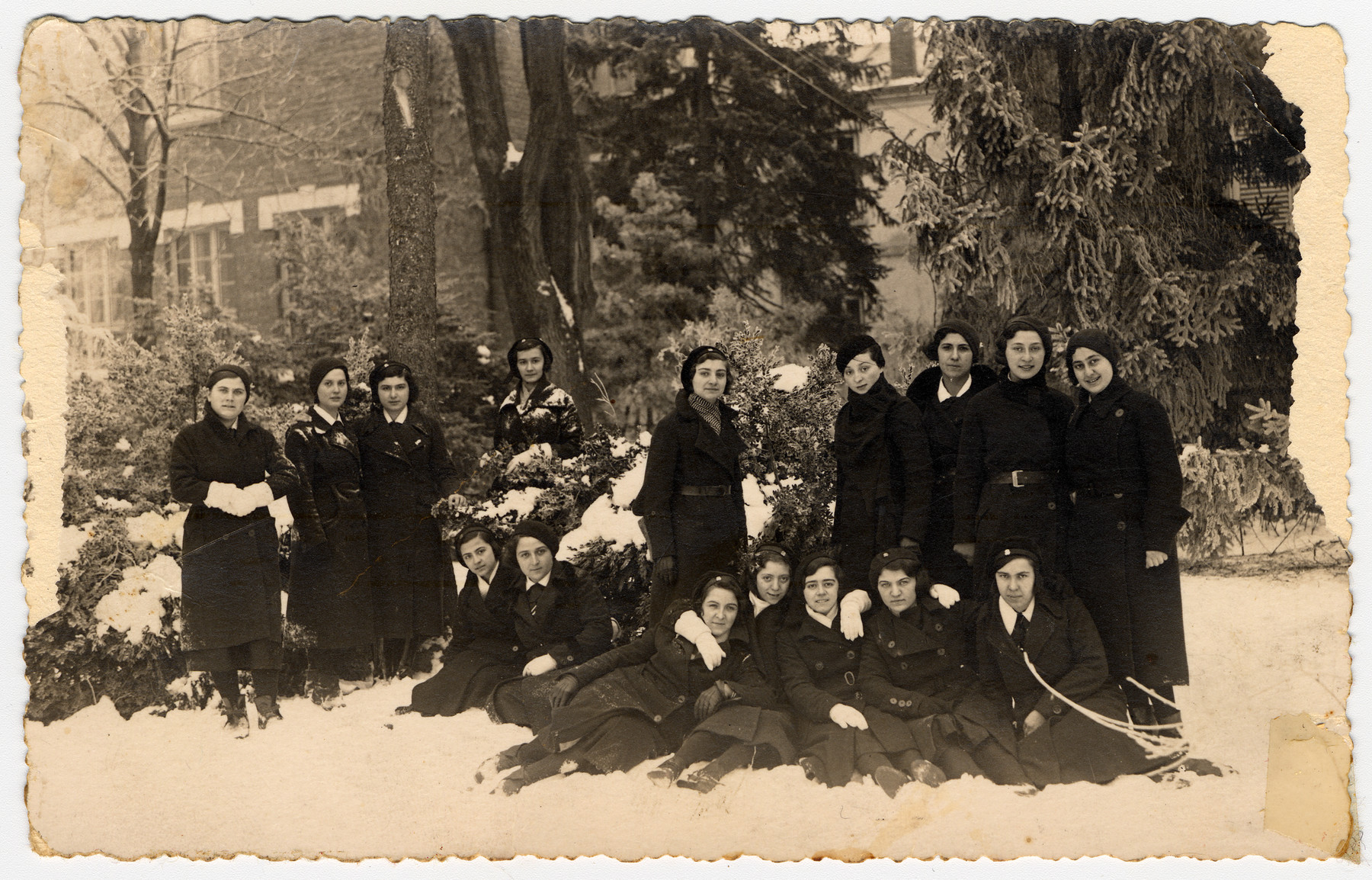 High school girls in Ruschuk Blugaria pose together in the snow.  Victoria Ashkenazi is seated in the first row, third from the right.