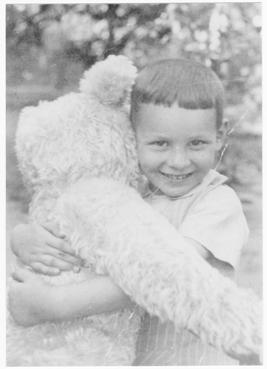 Hans Frank Rosenbaum hugs a giant stuffed teddy bear.