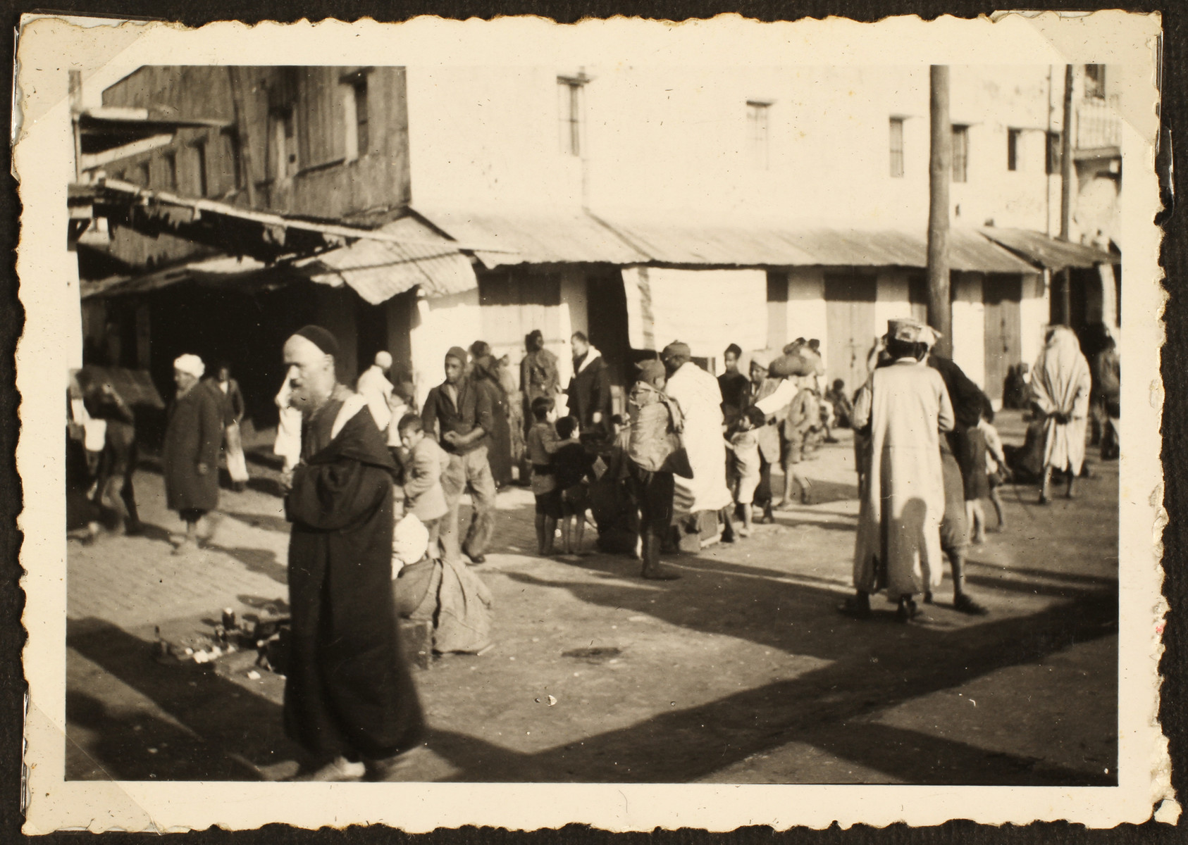 Arabs and refugees walk down a street in Casablanca.