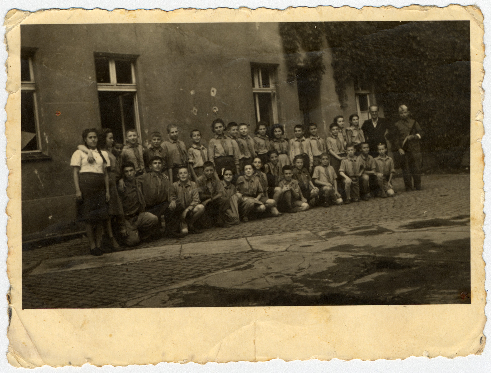 Group portrait of children in a children's home in Poland after the war.    Among those pictured is Uri Urmacher.  Most of the other children were collected by survivors of the Warsaw ghetto.