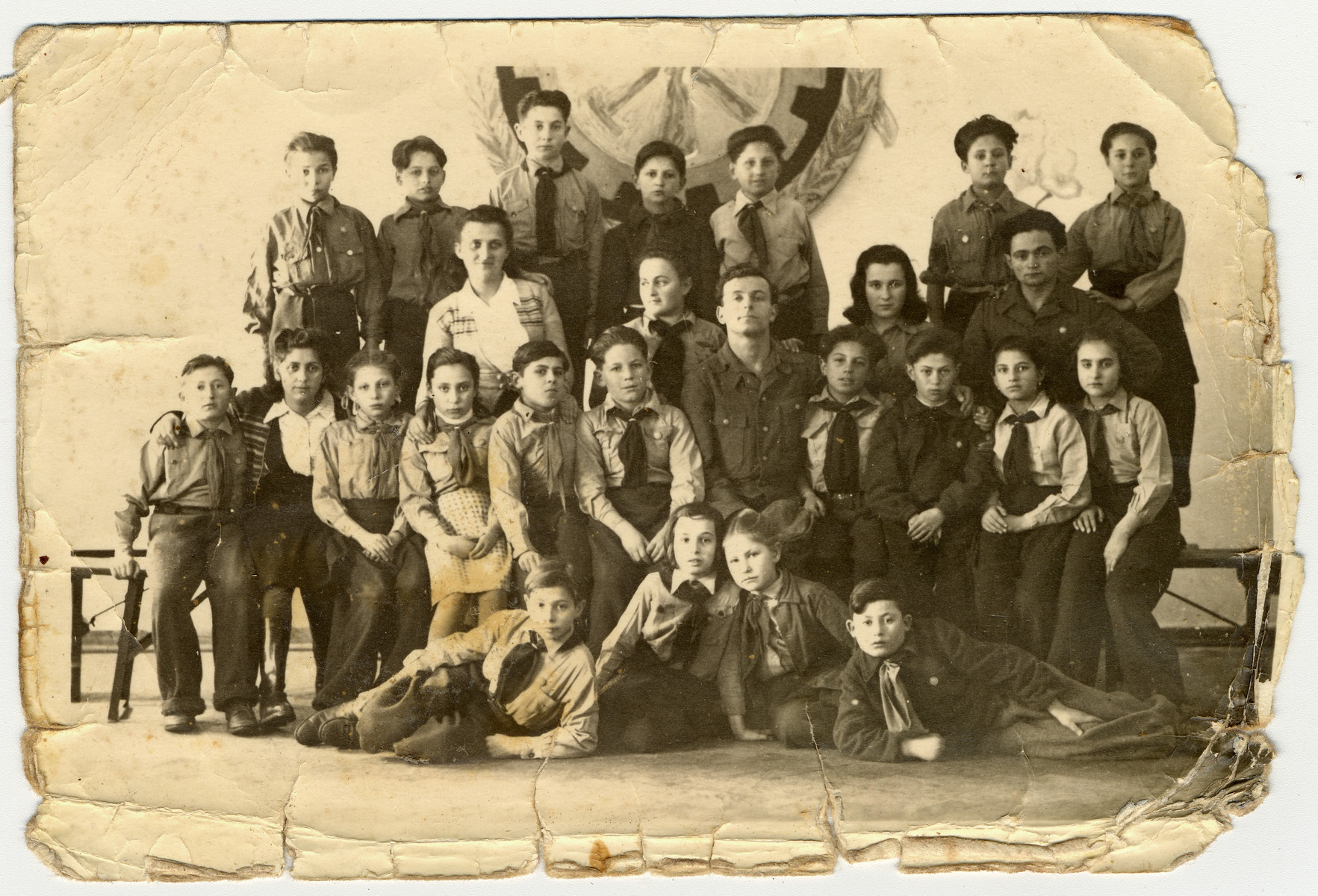 Group portrait of children in the Rosenheim children's home.  Among those pictured is Uri Urmacher.