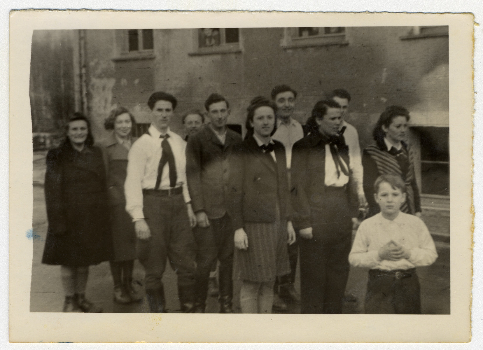A group of young displaced persons (many wearing Zionist uniforms) stand in formation at the Eschwege displaced persons' camp.