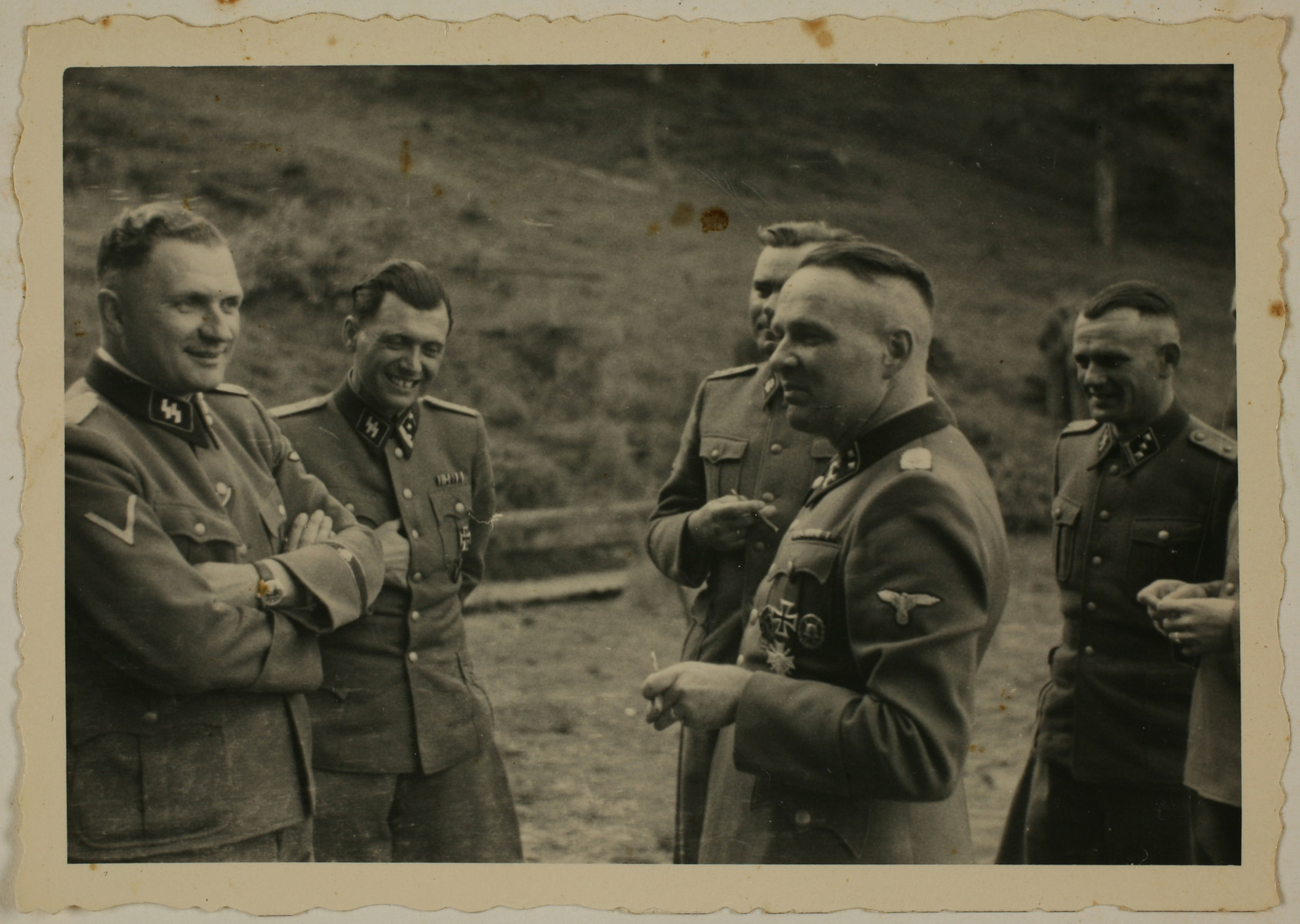 SS officers socialize in their retreat at Solahuette outside of Auschwitz.  From left to right are Richard Baer, Josef Mengele, Josef Kramer, Rudolf Hoess and Anton Thumann.  [Based on the officers visiting Solahutte, we surmise that the photographs were taken to honor Rudolf Hoess who completed his tenure as garrison senior on July 29.]