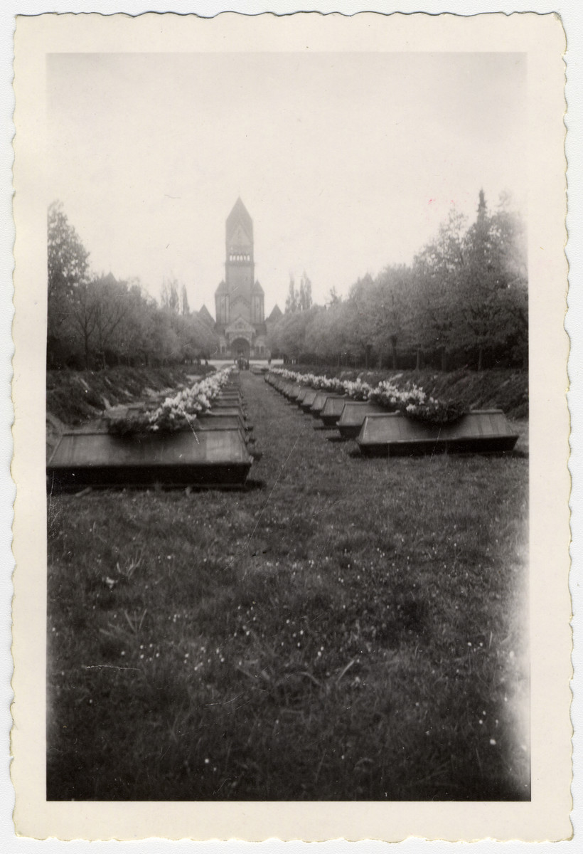 View of two lines of coffins at a mass burying of those found at Leipzig-Thekla.