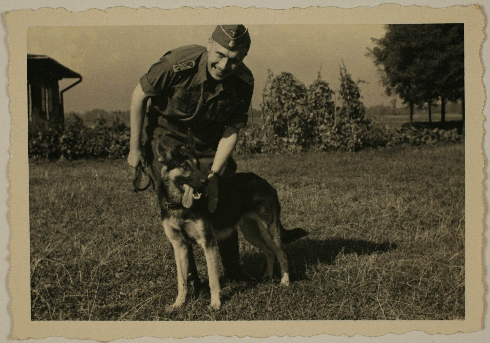 SS officer Karl Hoecker pets his dog, Favorit.