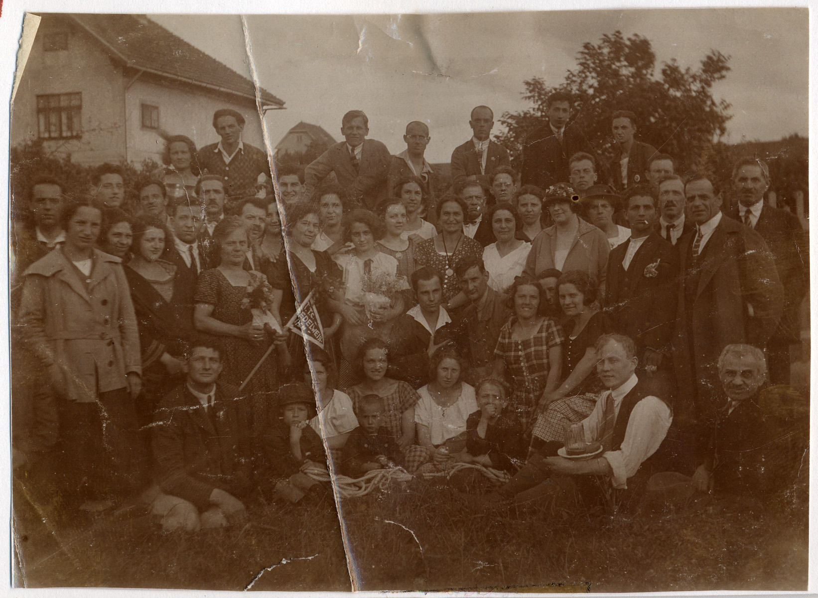 Group portrait of a hiking group on an outing.    Among those pictured is Hilda Wiener (far left, front).