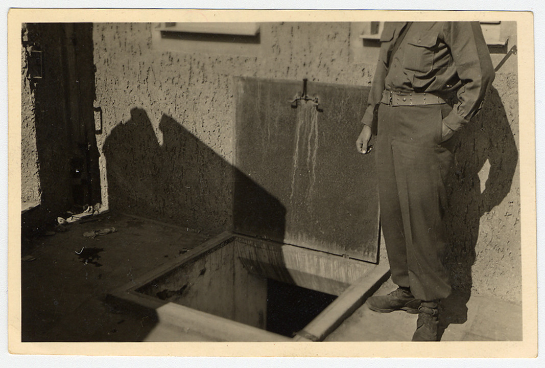 "Trapdoor inside the crematorium at Buchenwald concentration camp.  Original Caption Reads: ""Trap door to basement of crematorium through which victims were thrown. In basement, they were hung by chin and they would dip slowly. When dead, ... took them up to furnace where they were burned."""