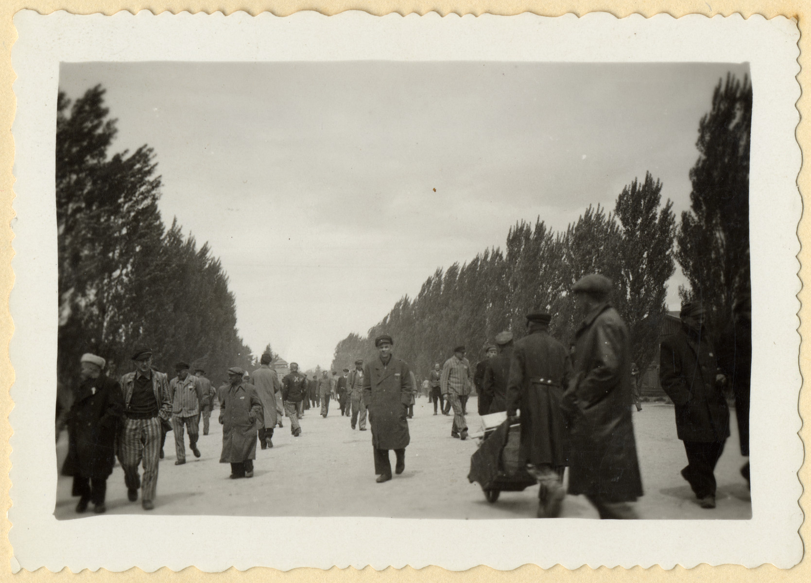 Survivors walk through the main open space of the Dachau concentration camp shortly after liberation.
