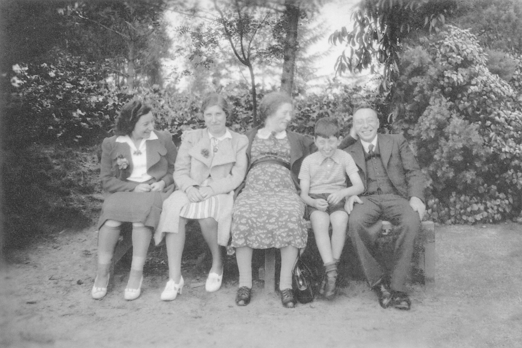 The Moses family poses on a park bench in prewar Netherlands.  Pictured from left to right are Lien Moses (Louis' half-sister), unknown, Froukje Moses, Louis Moses and Simon Moses.