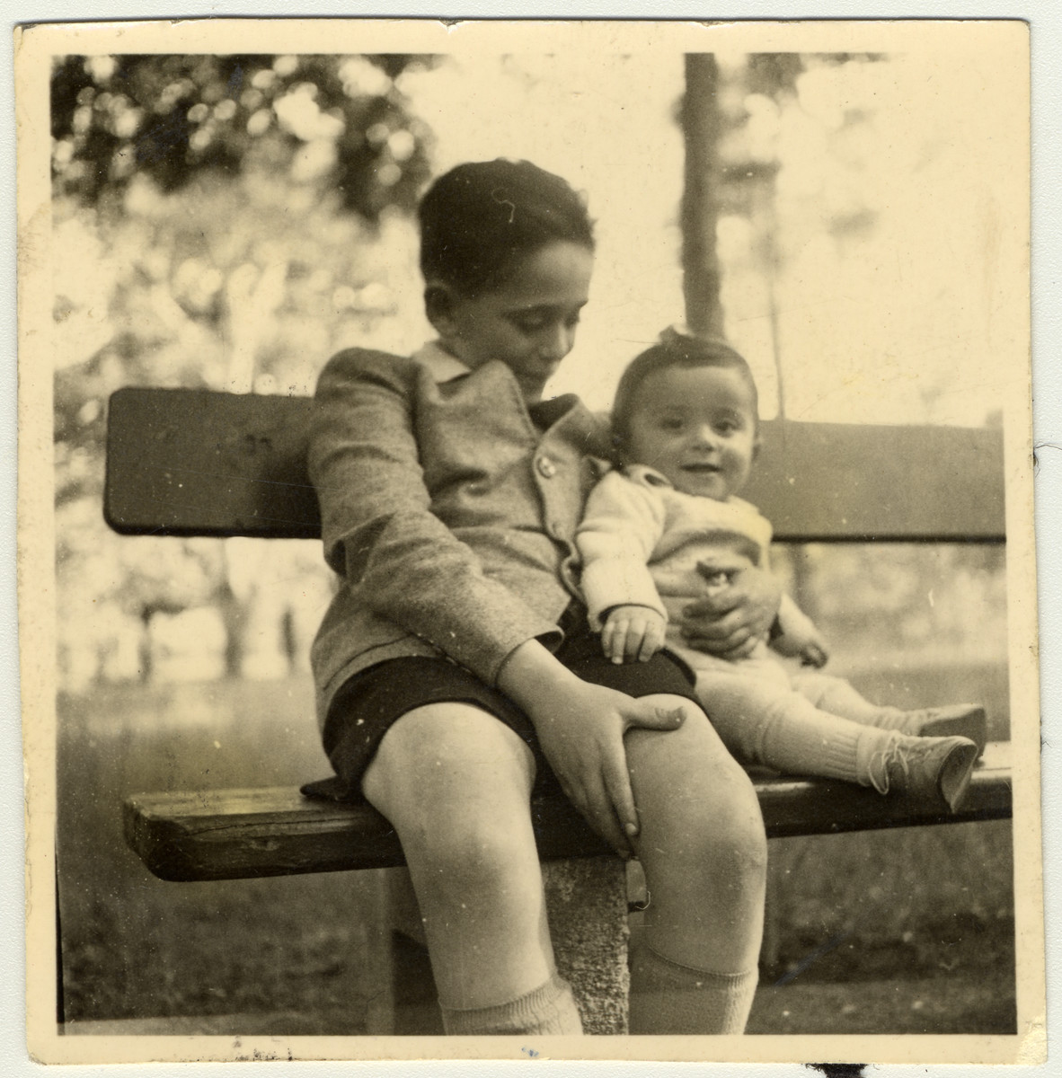 Janos Kovasc poses on a park bench with his half-brother, Istvan Reiner.