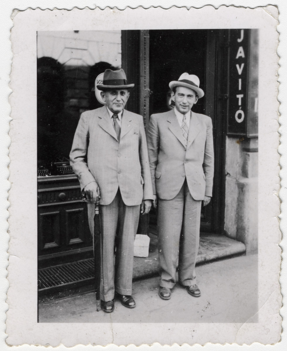 Sandor Kohn and his son Miklos stand outside a store front.  Sandor Kohn was killed in Auschwitz in 1944.  Miklos Kohn Kovacs survived the war in Bulgaria and was trained as a chemical engineer in Geneva, Switzerland.