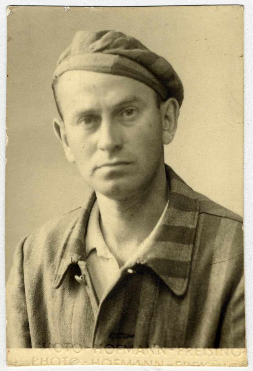 Studio portrait of Oskar Russ (step-father of the donor) wearing his concentration camp uniform shortly after liberation, .