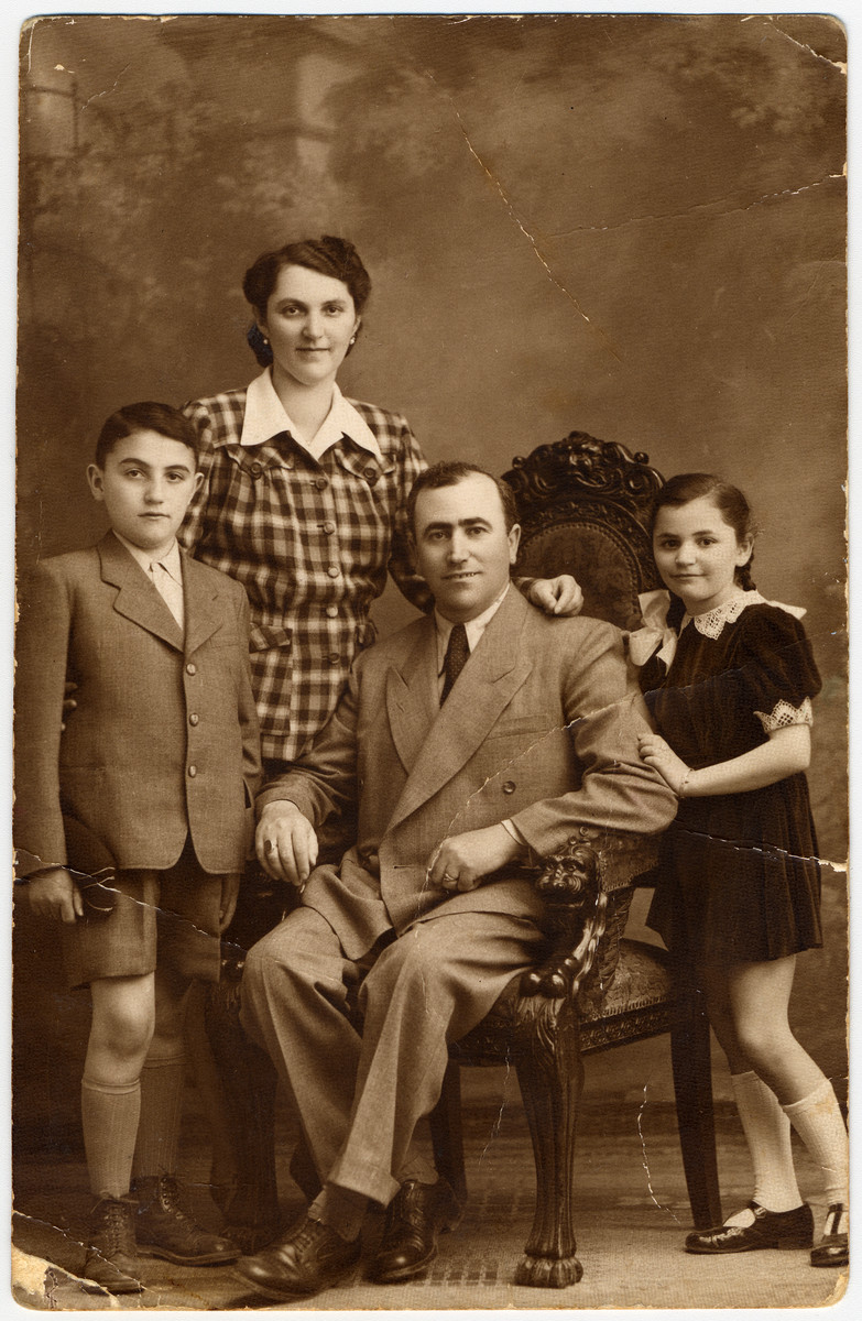 Prewar studio portrait of the Pollak family in Budapest, Hungary.  From left to right are Bondi, Blanka, Stefan and Yehudit Pollak.