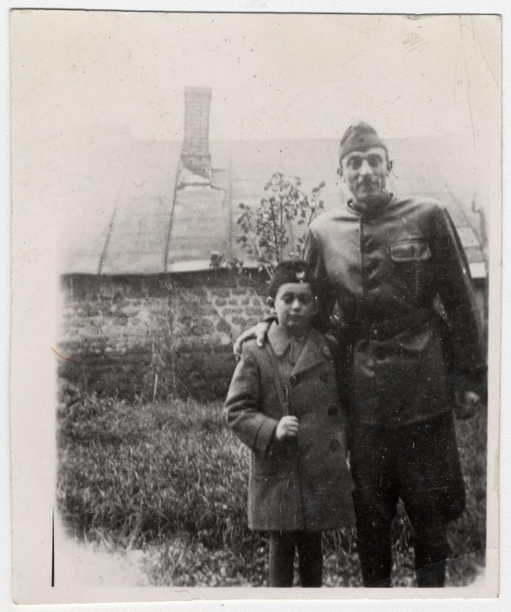 Janos Kovacs poses with his stepfather Bela Reiner who is wearing his Hungarian army uniform.  Shortly after the photo was taken, Jews were no longer permitted to wear the uniform.