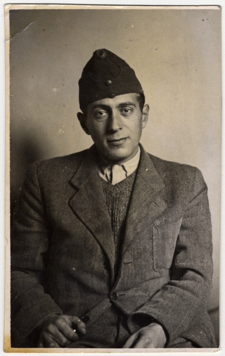 Studio portrait of Geza Kovacs taken shortly after he was inducted into the Hungarian Labor Service.  Jews could not wear army uniforms except for a cap.