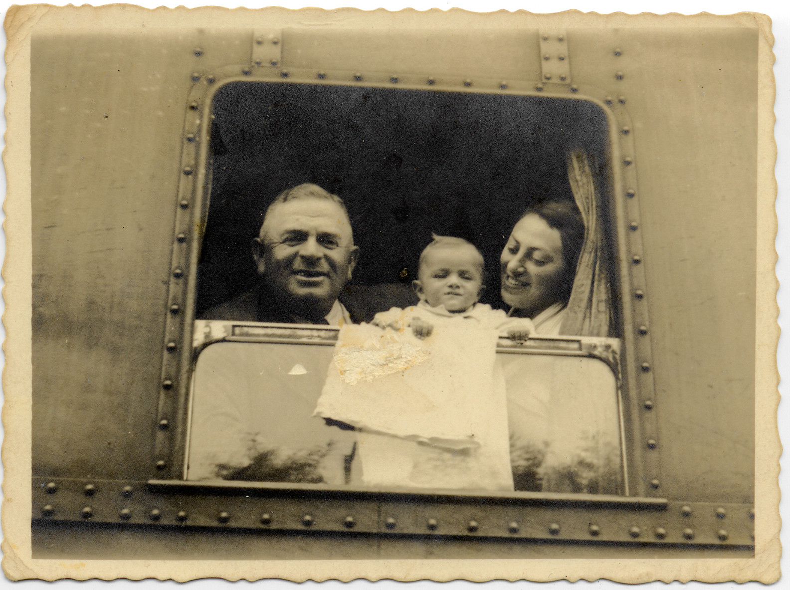 Pinchas Weissberg looks out a train window with his daughter, Natalia Schwarzwald, and her baby daughter, Elzbieta.