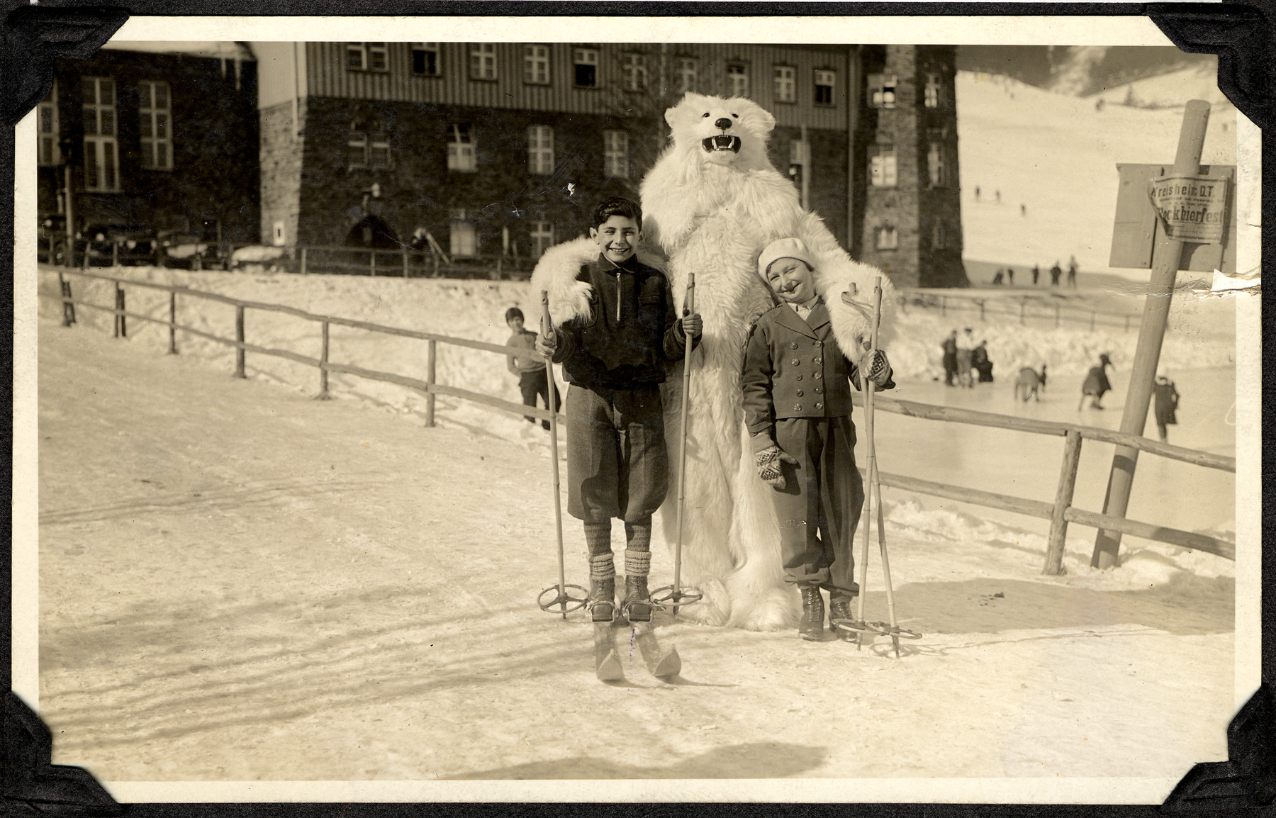 Egon and Edith Weiss pose with a someone in a bear costume while while on winter vacation in the mountains of Bavaria.