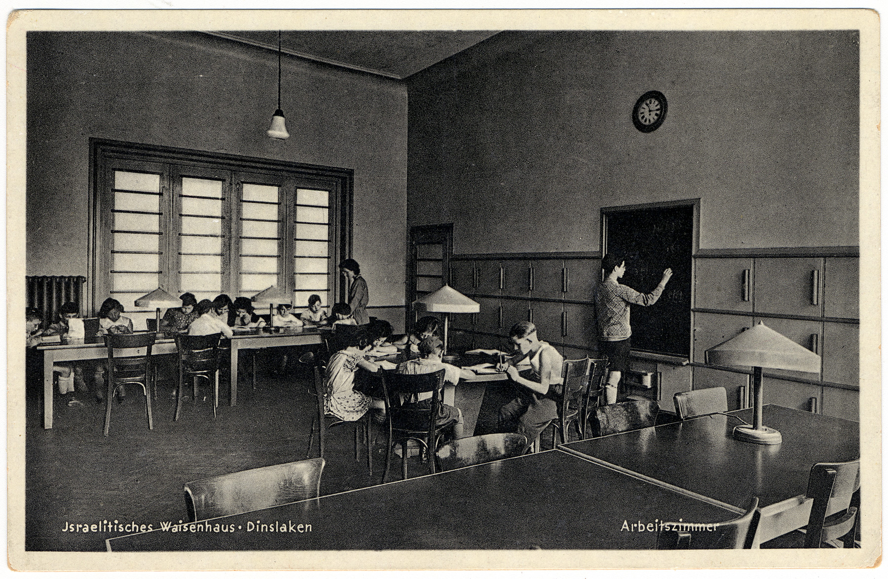 Children study in the classroom of the Waisenhaus of the Dinslaken Jewish orphanage.