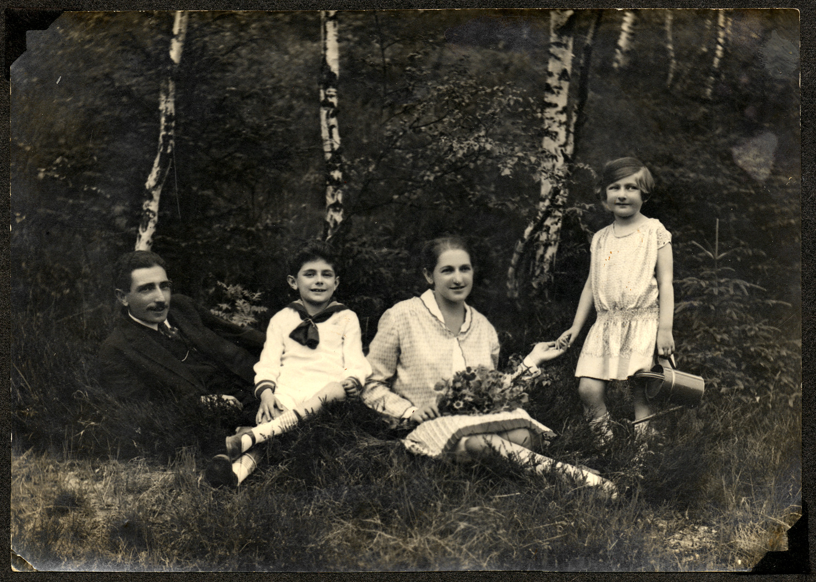 The Weiss family goes for an outing in the woods near Karlovy Vary.  From left to right are Emil, Egon, Olga and Edith Weiss.