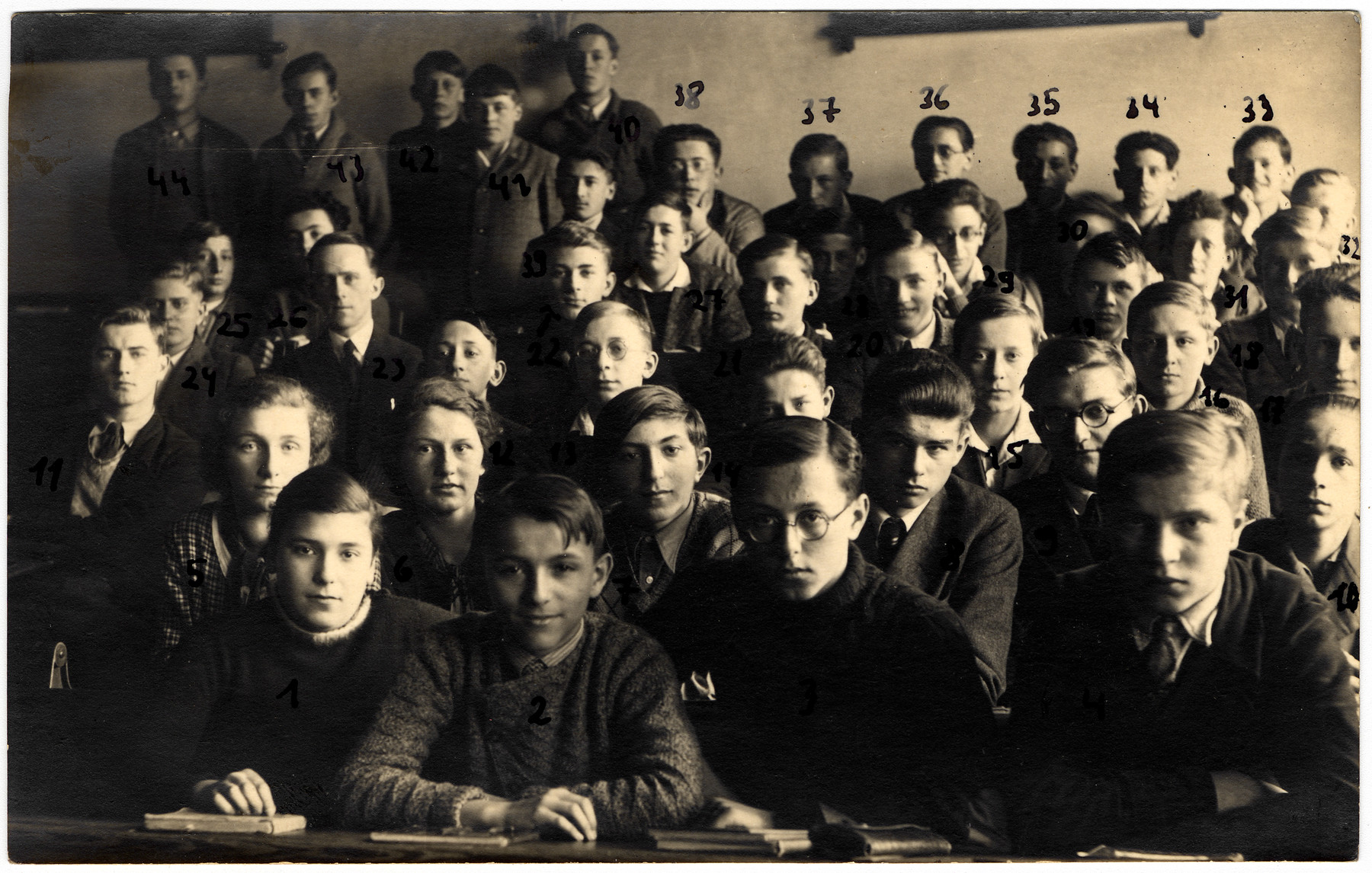 Group portrait of the students of the 4a class in the Gymnasium in Karlsbad.    Among those pictured is Egon Weiss.