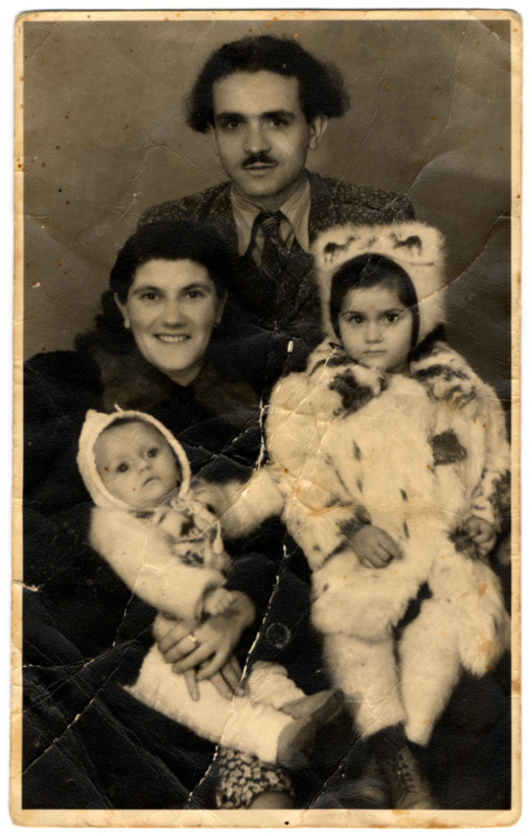 Postwar family portrait of the Virtgaym family.  Pictured are Yevgeniy and Rozaliya Virtgaym and their two daughters Eva and Susan.