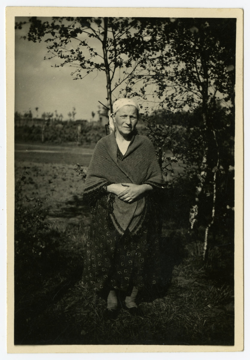 Chana Ruchla Grosman poses under a tree while on a summer vacation.