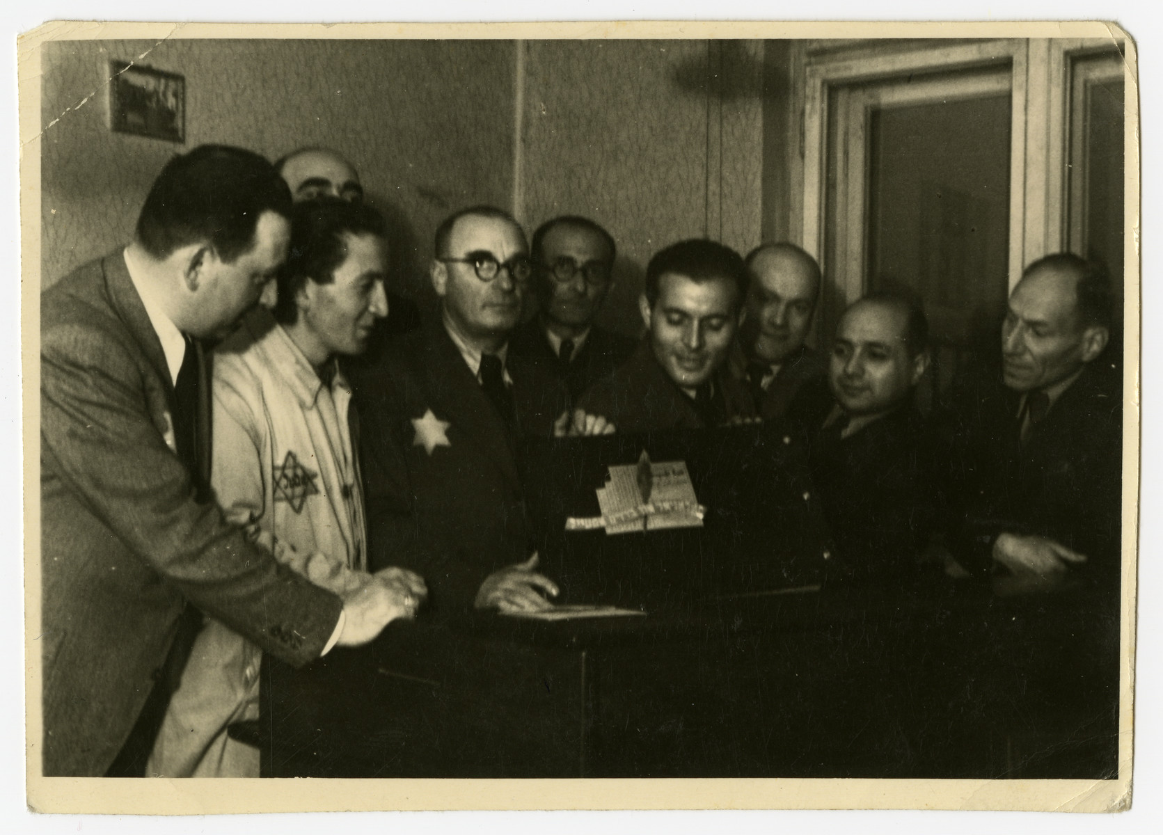 Group portrait of the managers of various workshops in the Lodz ghetto.  Among those pictured are Aaron Jakubowicz (far left), Mendel Grosman (second from the left), Max Szczesliwy (head of the food supply, third from left) and possible David Warszawski (far right).