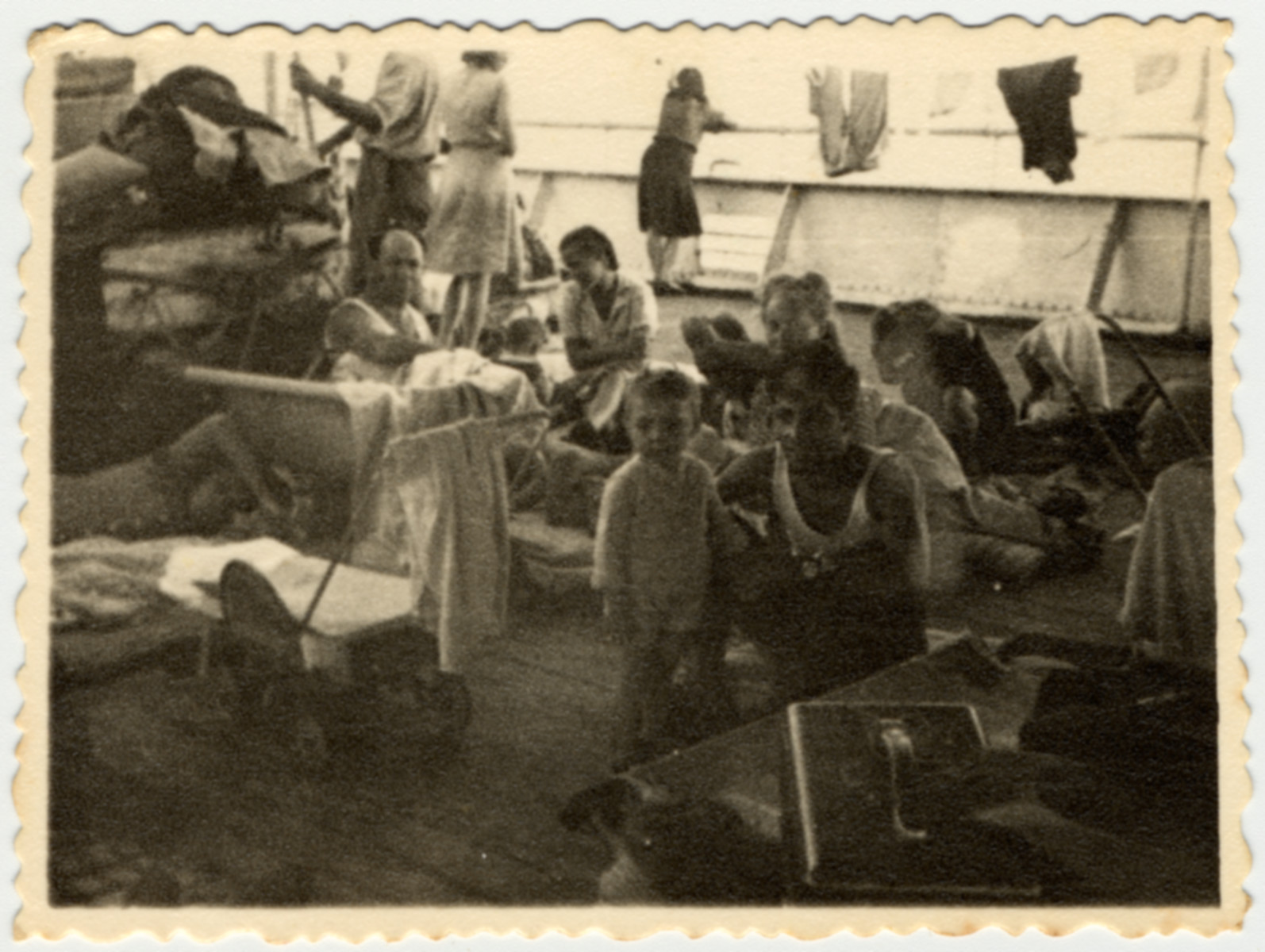 Immigrants relax on the deck of the Caserta while en route to Palestine.