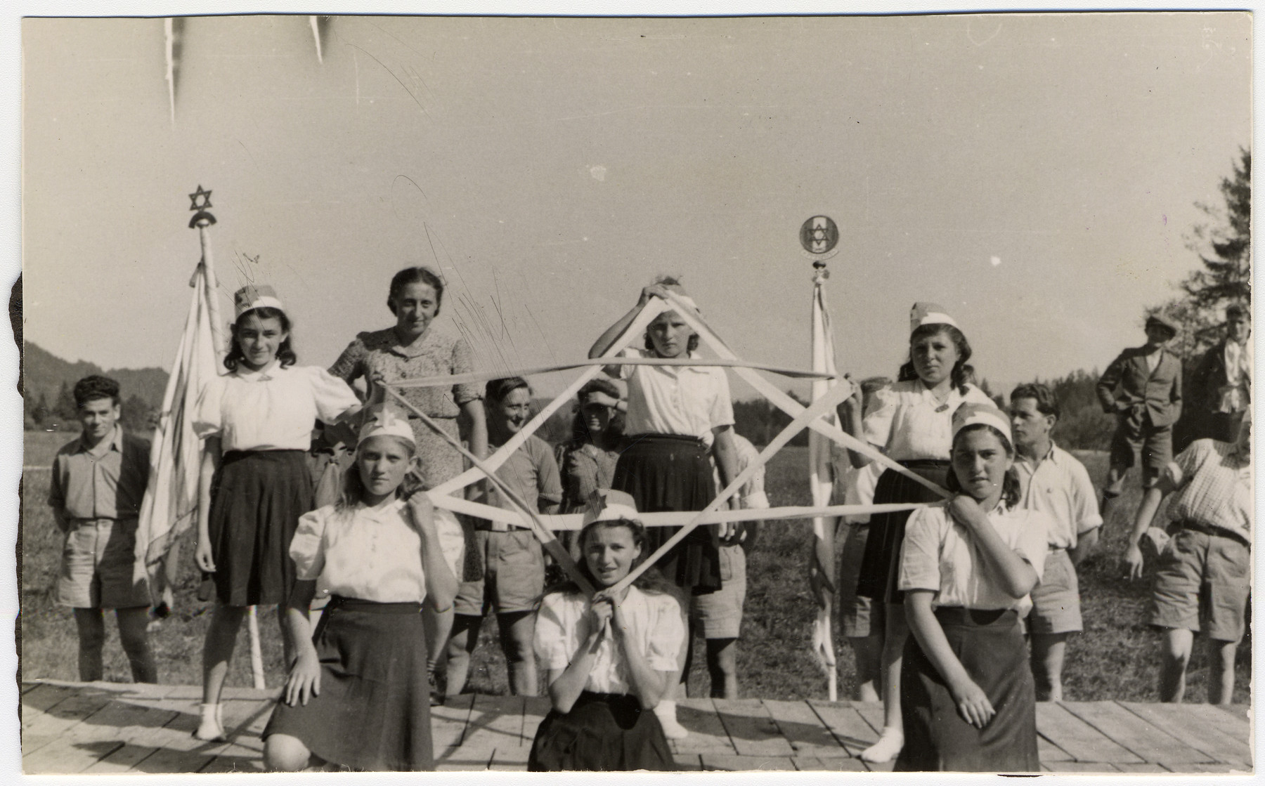 Girls use ribbons to make a Star of David in a Zionist pageant in the Deggendorf displaced persons' camp.